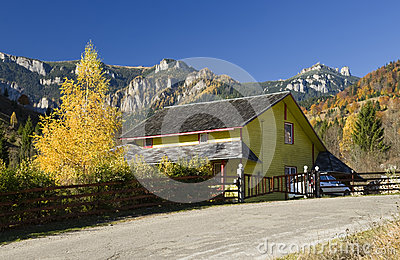 Chalet in autumn landscape