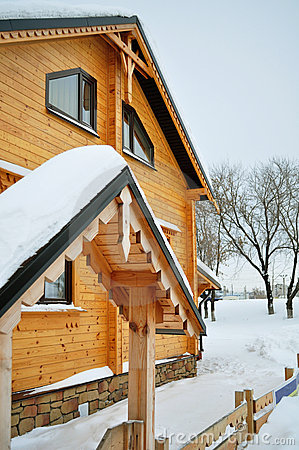 Chalet, wooden house and snow
