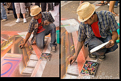 Chalk artist at work Editorial Photography