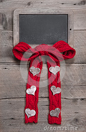 Chalk board for message with red knitted bow and hearts