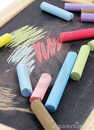 Chalks and black chalkboard
