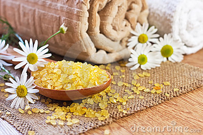 Chamomile salt in wooden spoon