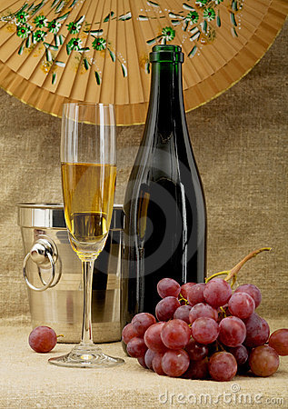 Champagne bottle, bucket, goblet and grapes