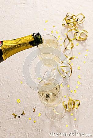 Champagne bottle fills glasses