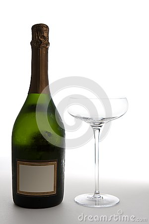 Champagne Bottle Next to an Empty Glass