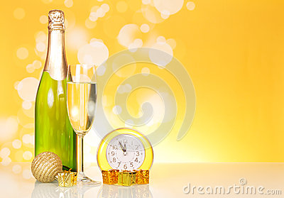 Champagne, clock and christmas decorations