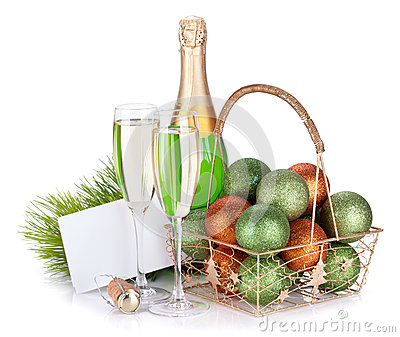 Champagne, empty gift card and christmas decor