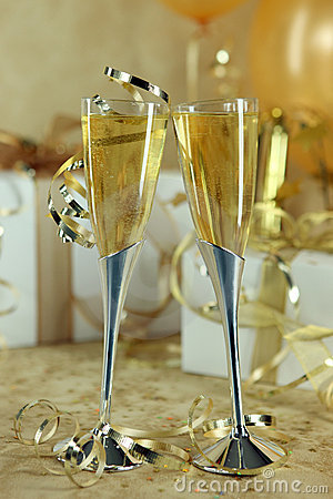 Champagne Flutes Leaning Towards One Another