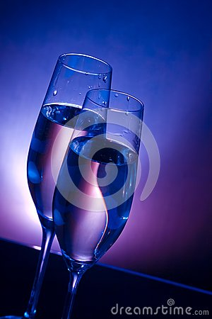 Free Champagne Flutes On Bar Table On Dark Blue And Violet Light Background Stock Photography - 36969232