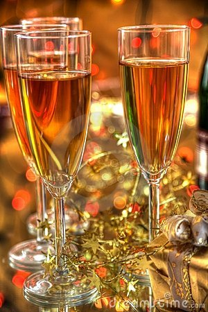 Champagne in glasses,gift box and lights