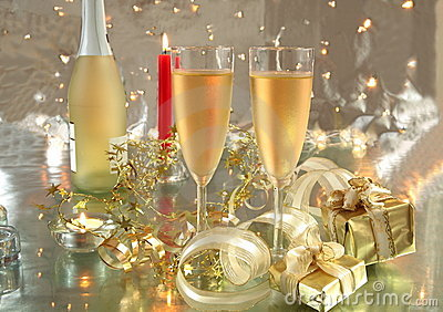 Champagne in glasses, gift box and lights