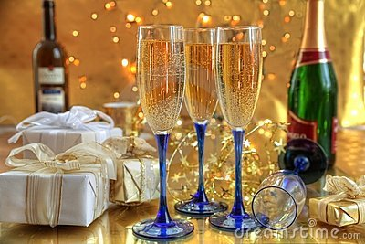 Champagne in glasses and gift boxes.