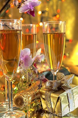 Champagne in glasses,gift and flowers