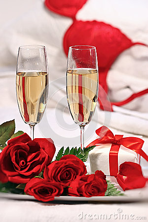 Champagne glasses and roses to celebrate Valentine s