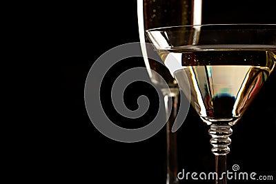 Champagne and martini glasses over black