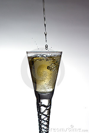 Champagne pouring into glass
