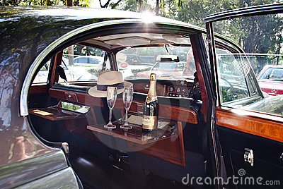 Champaigne in the car on Vintage Car Parade Editorial Stock Image