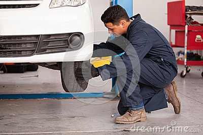 Changing a tire at an auto shop