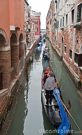 Channel in Venice with Gondolas Editorial Photo