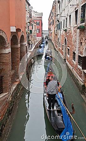 Channel in Venice with Gondolas Editorial Photo