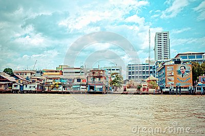 Chao Phraya River and houses in Bangkok Editorial Photography