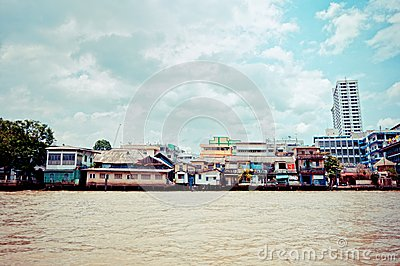Chao Phraya River and houses in Bangkok Editorial Stock Photo