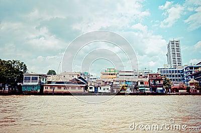 Chao Phraya River and houses in Bangkok Editorial Stock Photo