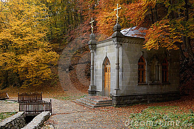 Chapel in autumn forest