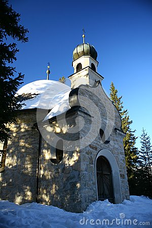 Chappel in the snow and mountain