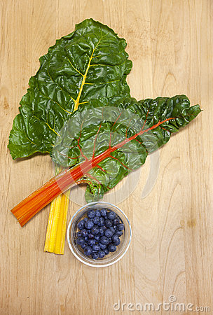 Chard and dish of blueberries.