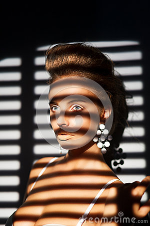 Free Charisma. Charming Woman S Face In Shadow Of Roller Blind Royalty Free Stock Image - 29025436