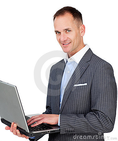 Charismatic businessman using a laptop