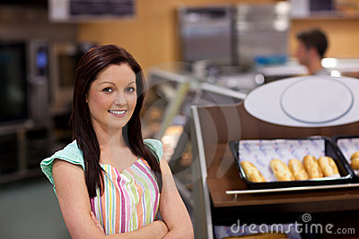 Charismatic female cook smiling at the camera