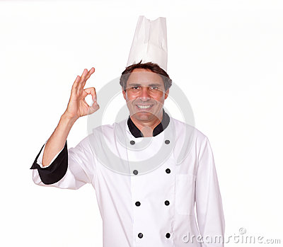Charismatic male chef gesturing positive sign