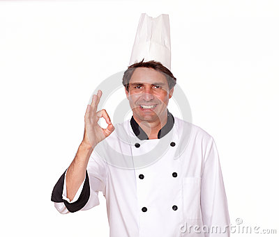 Charismatic male cook gesturing positive sign