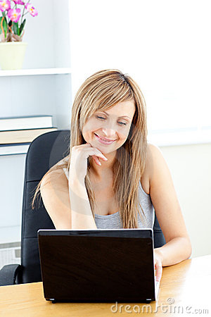 Charismatic young businesswoman using her laptop