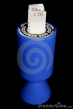 Charity collection tin with twenty pounds