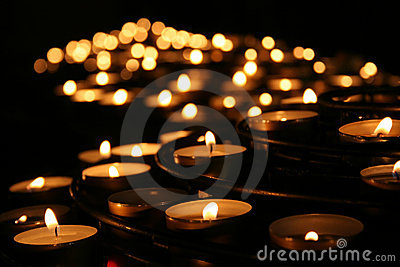 Charity. Praying candles in a temple.