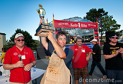 Charity rib eating contest winner. Editorial Stock Image