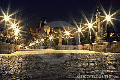 Charles bridge in Prague with lanterns