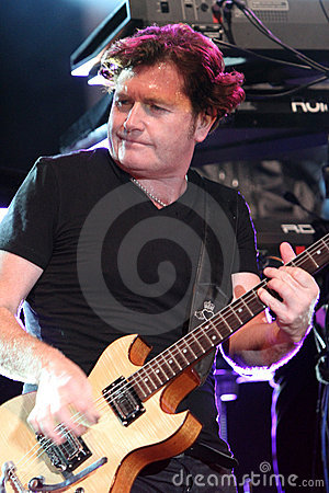 Charlie Burchill of Simple Minds, live concert Editorial Photo