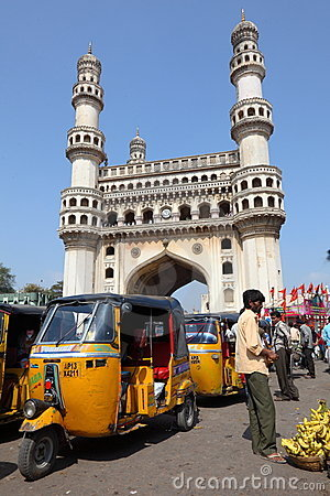 Charminar and tuk-tuks Editorial Stock Photo