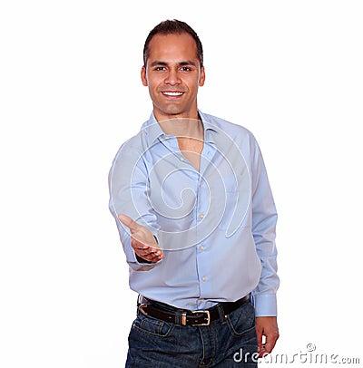 Charming adult man extending handshake at you