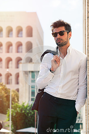 Free Charming And Fashionable Young Man With Sunglasses Stock Image - 76221901
