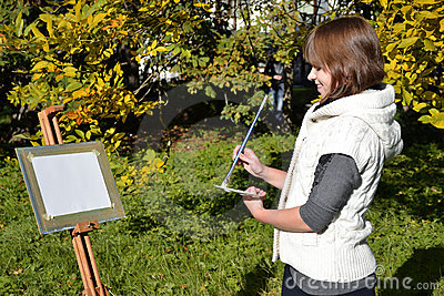 Charming artist in a park