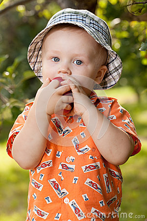 Charming babe eats delicious apple