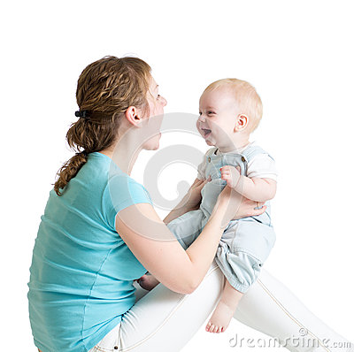 Free Charming Baby Boy Looking At Mommy And Smiling While Sitting On His Mother`s Knees. Mom Is Looking At Her Child Royalty Free Stock Photography - 95205327