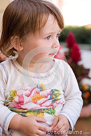 Charming baby toddler girl having fun.