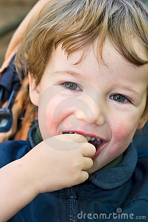 Charming boy smiles