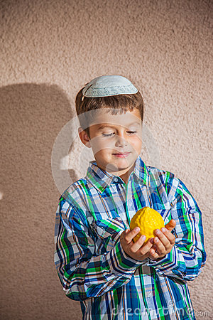 The Charming Boy In White Festive Skullcap Holds Etrog Stock Photo ...